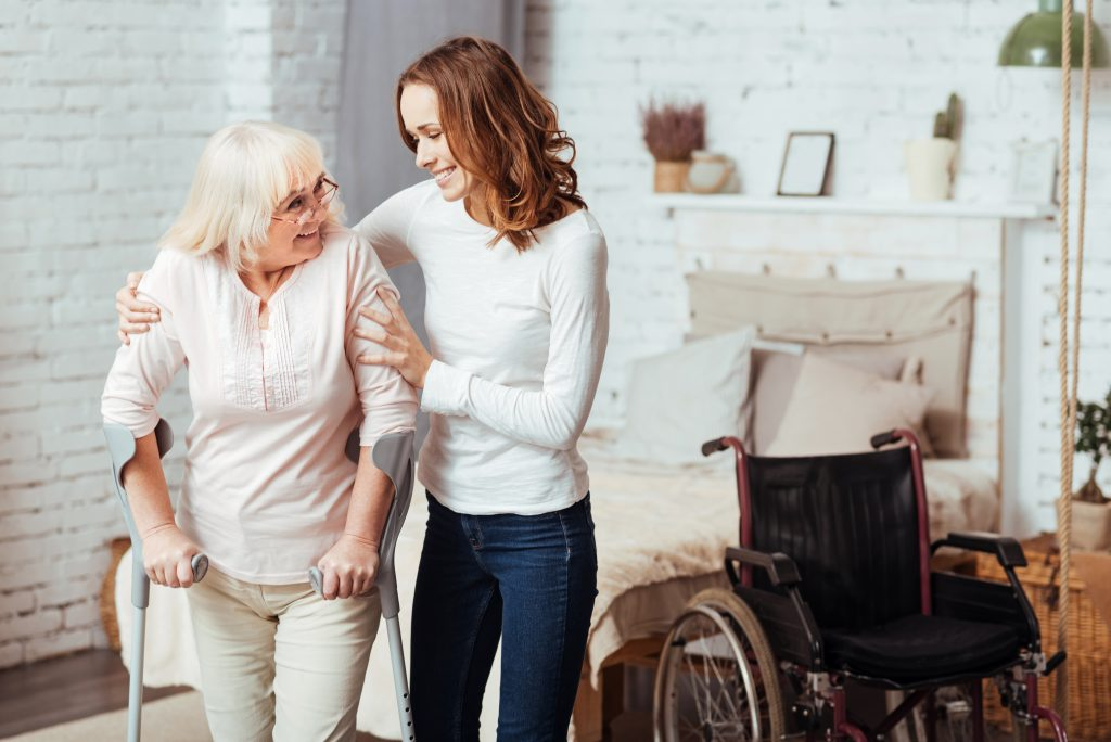 aged care support worker helping elderly client